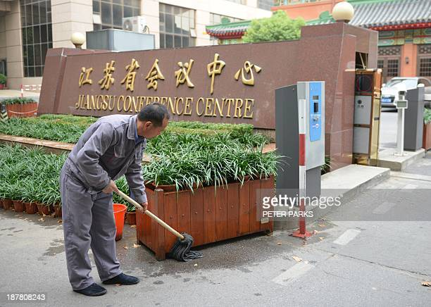 To go with ChinapoliticscorruptionFOCUS by BILL This photo taken on October 29 2013 shows a worker cleaning the outside of the Jiansu Conference...