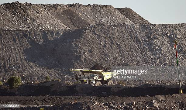 To go with ClimatewarmingUNCOP21AustraliacoalFEATURE by Madeleine Coorey A photo taken on November 18 shows a large truck driving trough an opencut...