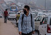 To go with ClimatewarmingUNCOP21IndiaFOCUS by Trudy Harris In this November 3 2015 photo Rigzen wears a mask as he heads to his morning class at a...