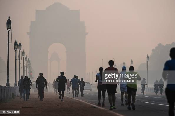 To go with ClimatewarmingUNCOP21IndiaFOCUS by Trudy Harris In this November 15 2015 photo Indian joggers exercise on a smoggy morning near the India...