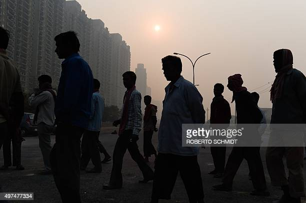 To go with ClimatewarmingUNCOP21IndiaFOCUS by Trudy Harris In this November 13 2015 photo Indian migrant workers walk toward the entrance of a newly...