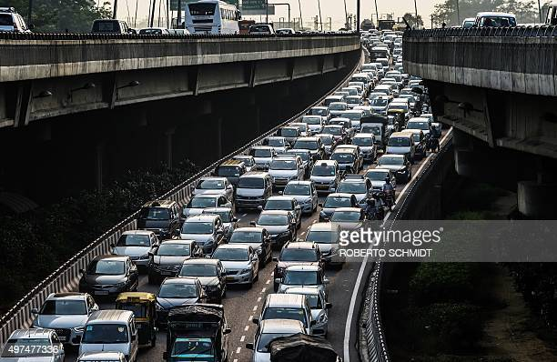 To go with ClimatewarmingUNCOP21IndiaFOCUS by Trudy Harris In this photo taken on October 15 a stream of cars backs up on an exit to a highway in New...