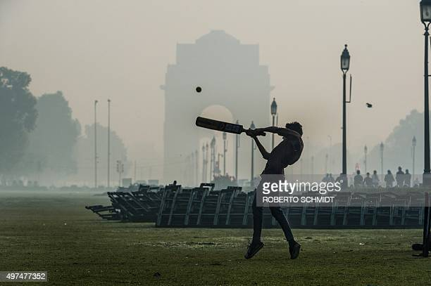 To go with ClimatewarmingUNCOP21IndiaFOCUS by Trudy Harris In this November 15 2015 photo an Indian youth plays cricket with friends near the India...