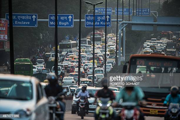 To go with ClimatewarmingUNCOP21IndiaFOCUS by Trudy Harris In this photo taken on October 15 slow moving traffic fills a highway in southern New...