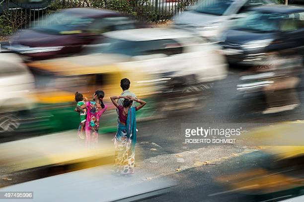 To go with ClimatewarmingUNCOP21IndiaFOCUS by Trudy Harris In this November 16 2015 photo an Indian couple with a child and a woman wait for a bus...