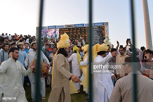 To go with CricketUAEPAKPathansPakistanAfghanistanFOCUS by Shahid HASHMI This photograph taken on December 19 shows Pathan spectators dancing as they...