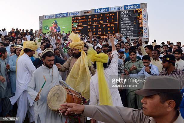 To go with CricketUAEPAKPathansPakistanAfghanistanFOCUS by Shahid HASHMI This photograph taken on December 19 shows Pathan spectators clad in...