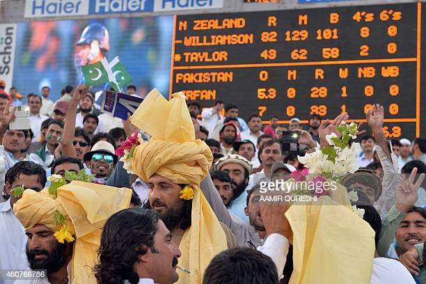 To go with CricketUAEPAKPathansPakistanAfghanistanFOCUS by Shahid HASHMI This photograph taken on December 19 shows Pathan spectators watching the...