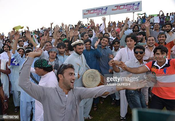 To go with CricketUAEPAKPathansPakistanAfghanistanFOCUS by Shahid HASHMI This photograph taken on December 19 shows Pathan spectators gesturing...