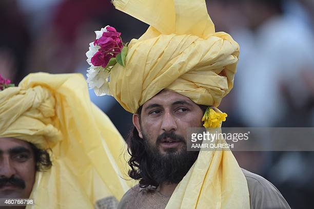 To go with CricketUAEPAKPathansPakistanAfghanistanFOCUS by Shahid HASHMI This photograph taken on December 19 shows a Pathan spectator in traditional...