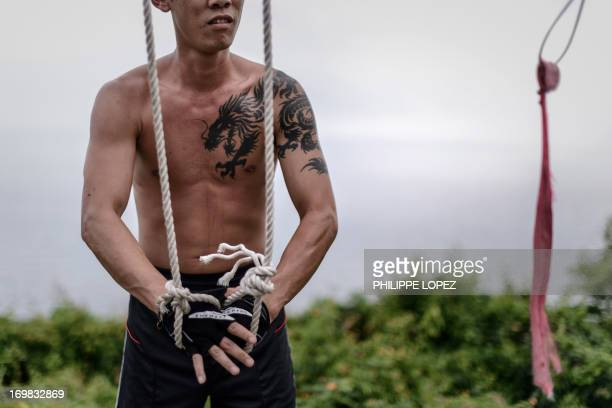 To go with DrugsKetamineHongKongSocialHealthcare by Joseph SINCLAIR This picture taken on May 15 2013 shows a ketamine abuser doing physical exercise...