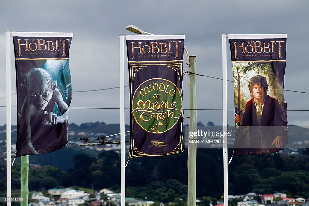 To go with 'Entertainment-NZealand-film-tourism-Hobbit,ADVANCER' by Neil Sands This picture taken on November 24th, 2012 shows flags advertising 'The Hobbit' movie fluttering at Wellington airport in Wellington. Hobbit fever has seized New Zealand ahead and the capital is dotted with giant sculptures of key characters such as Gandalf the wizard atop the Embassy cinema and a bug-eyed Gollum greeting visitors at the airport. AFP PHOTO / MARTY MELVILLE