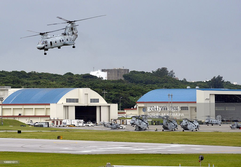 To go with feature story Japan-US-military-diplomacy by Kyoko Hasegawa In a picture taken on April 26, 2010 a US Marines' CH-46E helicopter takes off from the US Marine Corps Air Station Futenma in Ginowan, Okinawa prefecture. The deafening US military jets sometimes fly so low that the pilots' faces are visible to the people living around their airbase on the southern Japanese island of Okinawa. The base has been there since the palm-fringed island emerged from the battles of Word War II to become Japan's main US military staging area -- but many locals say they'll never get used to the ear-splitting noise.