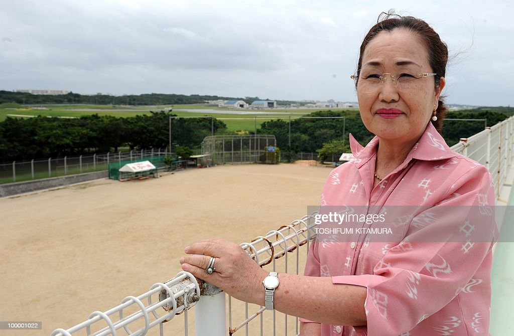 To go with feature story Japan-US-military-diplomacy by Kyoko Hasegawa In a picture taken on April 26, 2010, Harumi Chinen, the principal of Futenma primary school, which is located next to the US Marines Futenma Air Station, poses on the roof of her school in Ginowan, Okinawa prefecture. The deafening US military jets sometimes fly so low that the pilots' faces are visible to the people living around their airbase on the southern Japanese island of Okinawa. The base has been there since the palm-fringed island emerged from the battles of Word War II to become Japan's main US military staging area -- but many locals say they'll never get used to the ear-splitting noise.