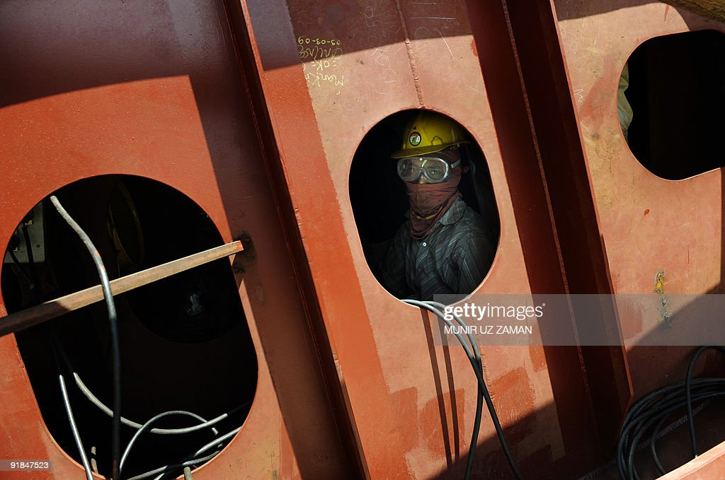 To go with FinanceeconomyBangladeshSingaporeshipping by Shafiq Alam In this image taken on September 2 a Bangladeshi labourer looks out from a ship...