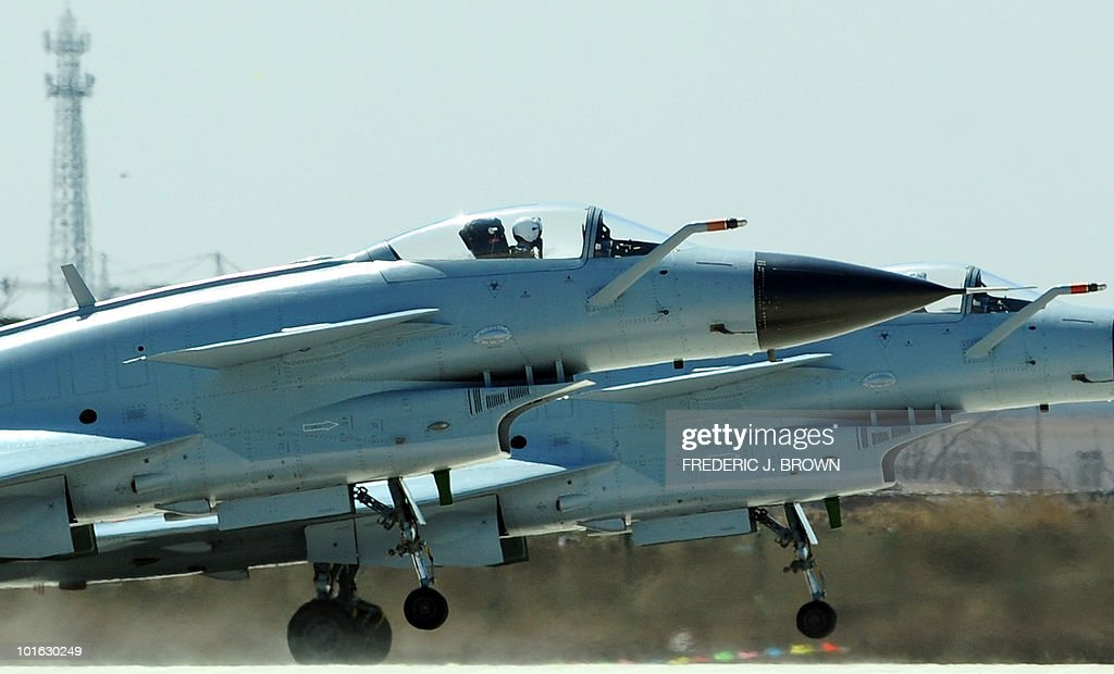 To go with focus story China-military-media by Francois Bougon (FILES) In a file picture take on April 13, 2010 Air Force pilots take off in Chinese J-10 fighter jets for a display to which journalists were invited at the Yangcun Air Force base of the People's Liberation Army Air Force in Tianjin, southeast of Beijing. In his celebrated treatise 'The Art of War', Chinese military strategist Sun Tzu warned against transparency. Today, China's army is ignoring his advice and has launched a media charm offensive in the hope of calming fears over its growing power. AFP PHOTO/FILES/Frederic J. BROWN