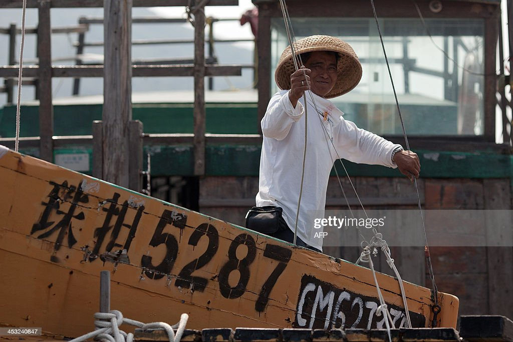 To go with Hong KongEconomyCultureFishingSocial FEATURE by Issam AHMED This picture taken on October 9 2013 shows 55year old Ming ChengWah who was a...