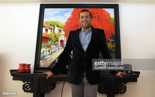 To go with IndiaBollywoodfilmliteratureFEATURE by Udita Jhunjhunwala In this photograph taken on July 17 Indian author Chetan Bhagat poses at his...