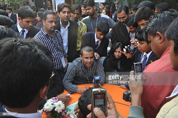 To go with IndiabooksfestivalFOCUS by Giles Hewitt Bestselling Indian author Chetan Bhagat is surrounded by picture and autograph hunters at the...
