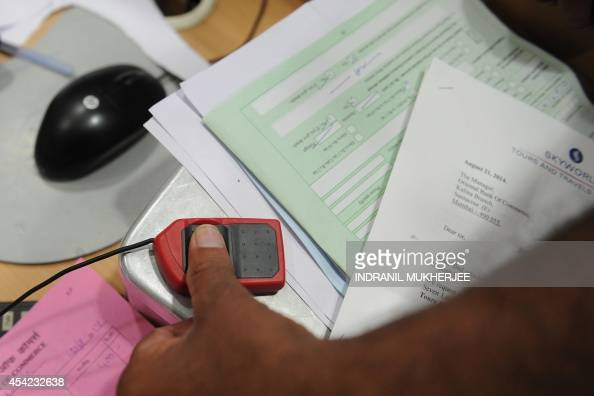 To go with IndiaeconomypoliticsbankingFOCUS by Penelope MACRAE In this photograph taken on August 22 a banking customer gets his biometric...