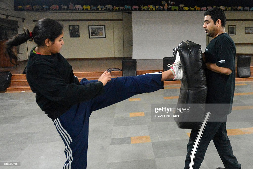 To go with 'India-rape-politics-women-selfdefence,FOCUS' by Abhaya Srivastava This picture taken on January 2, 2013 shows an Indian woman (L) sparring with a trainer during a self-defence class in New Delhi. After nearly three weeks of lurid reporting on a horrifying gang-rape in New Delhi, women in the Indian capital say they are more anxious than ever, leading to a surge in interest in self-defence classes.