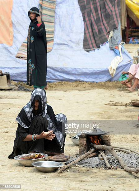 To go with 'IndiareligionunrestwomenrapeFOCUS' by Abhaya Srivastava In this photograph taken on October 7 2013 Indian Muslim women prepare bread...