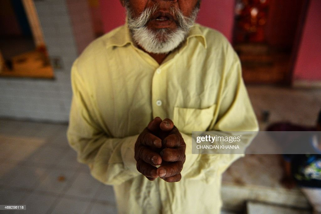 To go with IndiasocialhealthleprosyFEATURE by Abhaya SRIVASTAVA In this photograph taken on March 11 a cured patient of leprosy looks on in a leprosy...