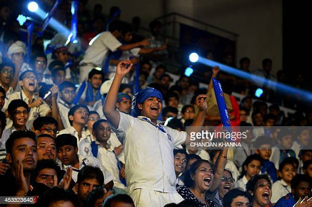 To go with IndiaSportLifestyleKabaddi by Abhaya Srivastava In this photograph taken on August 6 a young supporter cheers at a match between Dabang...