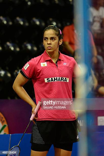 To go with ' IndiaSportWomen' FOCUS by Abhaya Srivastava In this photograph taken on March 25 Saina Nehwal of India reacts during her women's...