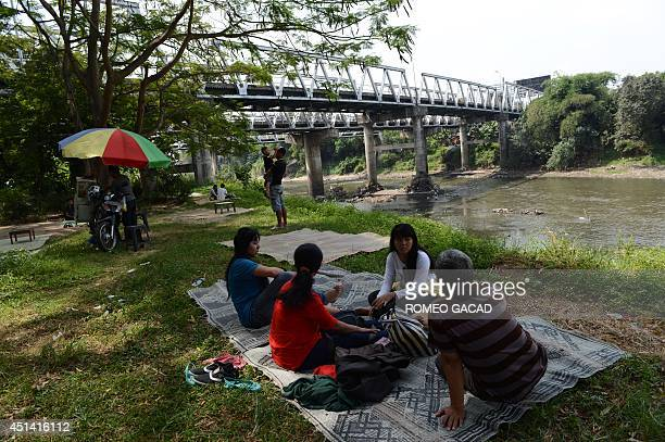 To go with IndonesiaelectionFEATURE by Arlina Arshad In this photograph taken on June 15 residents of Solo city hometown of Indonesian frontrunner...