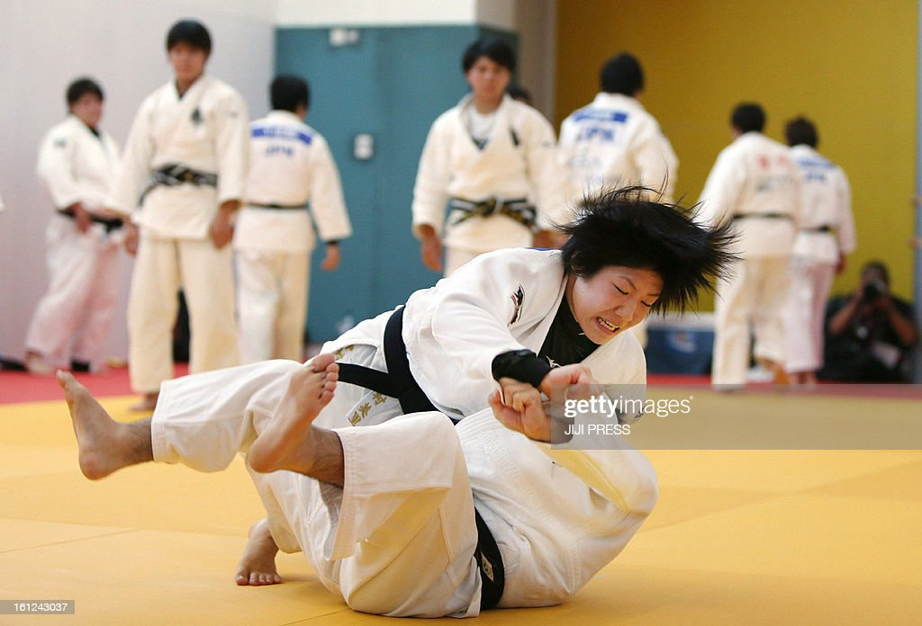 To go with 'Japan-bullying-education-sports-judo,FOCUS' by Shigemi Sato This picture taken on July 23, 2012 shows female judoka takeing part in a judo training session before the Olympic Games in London. The resignation of the national women's judo coach who beat athletes with a bamboo sword was a nasty reminder of how Japan's sporting world still draws on the traditions that led the country to war last century, experts say.
