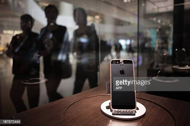 To go with LifestyleHongKongChinaluxuryFOCUS by Beh Lih Yi This picture taken on April 23 2013 shows a 25760 USD custombuilt iPhone 5 with a rose...