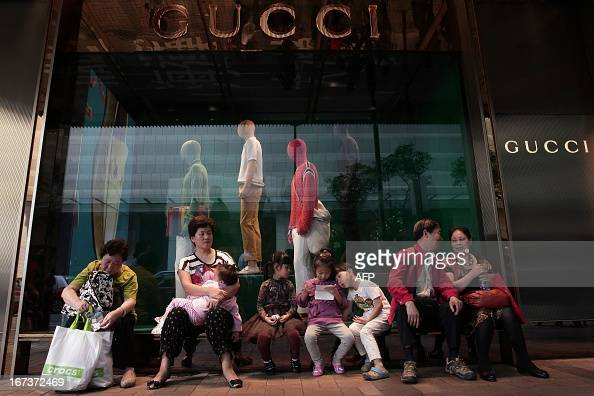 To go with LifestyleHongKongChinaluxuryFOCUS by Beh Lih Yi This picture taken on April 23 2013 shows Chinese mainland tourists sitting outside a...