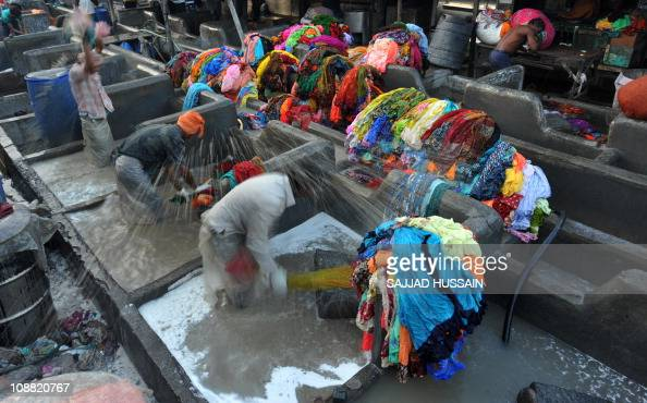 To go with LifestyleIndiaconsumertechnologyFEATURE by Karishma VyasWashermen clean clothes by hand at Dhobi Ghat in the Indian city of Mumbai on...