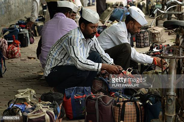 To go with 'LifestyleIndiafoodtechnologytiffin' FOCUS by PETER In this photograph taken on September 4 Indian dabbawallahs or lunchbox deliverymen...