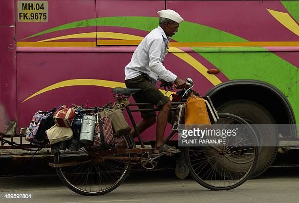 To go with 'LifestyleIndiafoodtechnologytiffin' FOCUS by PETER In this photograph taken on September 4 an Indian dabbawallah or lunchbox deliveryman...