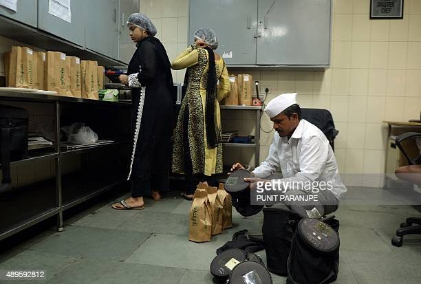 To go with 'LifestyleIndiafoodtechnologytiffin' FOCUS by PETER In this photograph taken on September 2 an Indian dhabawallah packs lunch boxes at an...