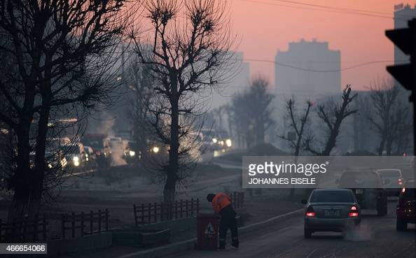 To go with MongoliaclimateenvironmentweatherFEATURE by Kelly Olsen This photo taken on February 9 shows a street sweeper at work in Ulan Bator...