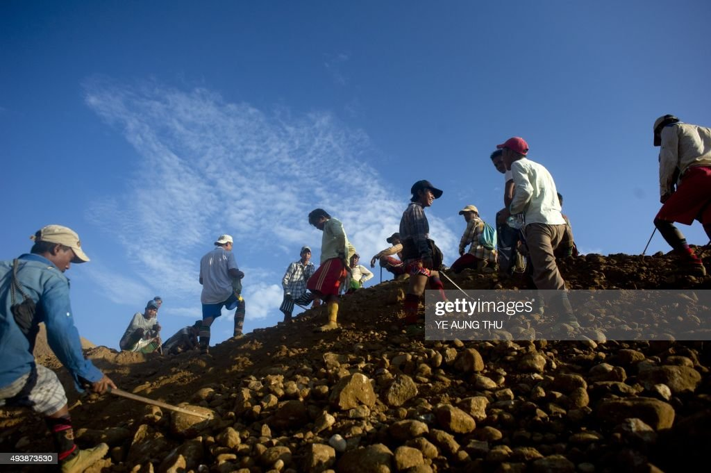 To go with MyanmarChinaminingeconomypoliticsresources by Kelly MACNAMARA Phyo Hein KYAW This photo taken on October 4 2015 shows freelance miners...