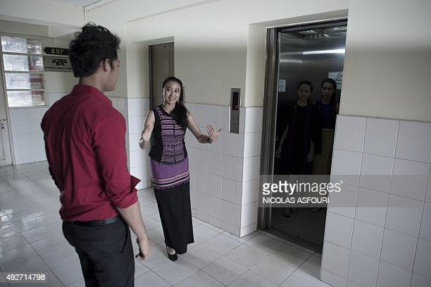 To go with MYANMARLIFESTYLEWOMENSOCIETYCULTUREECONOMY by Preeti JHA In a photo taken on August 19 2015 a student practices elevator manners next to...