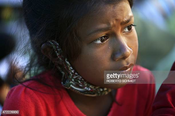 To go with 'NepalQuakeChildrenHealth' FOCUS by Claire Cozens In this photograph taken on May 4 tenyearold Nepalese child Ranju Giri speaks to...