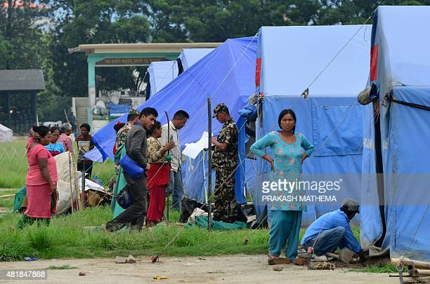 To go with ' NepalQuakeEconomyAid ' by Paavan Mathema In this photograph taken on July 23 Nepalese army personnel collect data at a relief camp for...