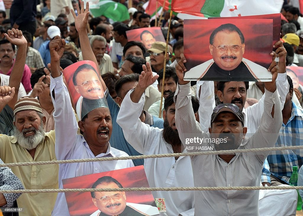 To go with Pakistan-Britain-Politics-MQM-Hussain,FOCUS by Ashraf KHAN Supporters of Pakistan's Muttahida Qaumi Movement (MQM) party hold photographs of party leader <a gi-track='captionPersonalityLinkClicked' href=/galleries/search?phrase=Altaf+Hussain+-+Muttahida+Qaumi+Movement&family=editorial&specificpeople=12871789 ng-click='$event.stopPropagation()'>Altaf Hussain</a> during a sit-in protest calling for Hussain's release in Karachi on June 4, 2014. For more than two decades, <a gi-track='captionPersonalityLinkClicked' href=/galleries/search?phrase=Altaf+Hussain+-+Muttahida+Qaumi+Movement&family=editorial&specificpeople=12871789 ng-click='$event.stopPropagation()'>Altaf Hussain</a> has wielded control of this freewheeling, violent city of 20 million half a world away from his drab London suburb home. The 60-year-old is revered by his fiercely loyal supporters -- mainly ethnic Mohajirs who migrated from India at the time of partition, while critics accuse him of running his party as a violent mafia-like organisation. AFP PHOTO/ Asif HASSAN
