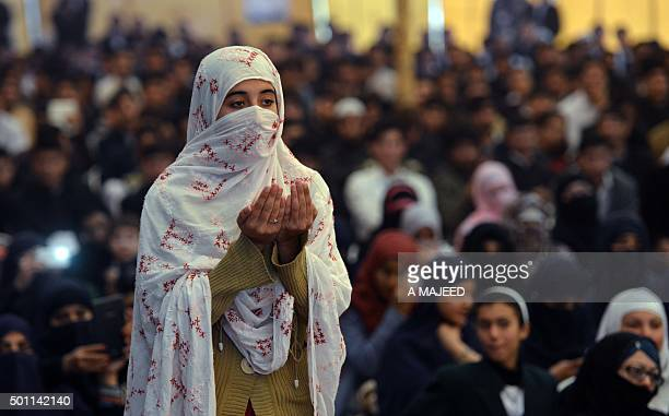 To go with 'PakistanUnrestNorthwest' FOCUS by Sajjad Tarakzai In this photograph taken on December 8 a Pakistani woman prays for the victims of the...