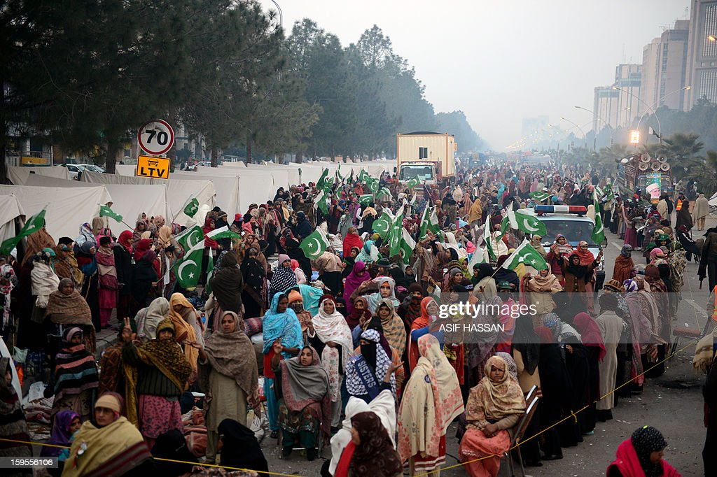 To go with Pakistan-unrest-politics-Islamabad,FOCUS by Nasir Jaffry Supporters of moderate preacher Tahir-ul Qadri gather on the third day of a protest rally in Islamabad on January 16, 2013. An estimated 25,000 to 50,000 people have poured into Islamabad from across the country, devoted followers of moderate preacher Tahir-ul Qadri who is calling for the government to step down and radical reforms. It is the largest protest in the capital since the Pakistan People's Party won elections in 2008, ending a decade of military rule and forming what in March will be the country's first civilian government to complete a term in office. AFP PHOTO/Asif HASSAN