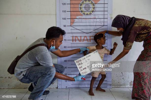 To go with 'SEAsia migrants Indonesia' Focus by Olivia Rondonuwu In this picture taken on May 21 a Rohingya boy from Myanmar is photographed during...