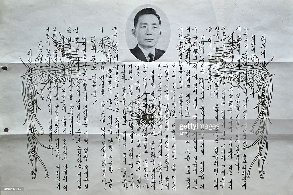 To go with SKoreaGermanyhistoryminersFEATURE by Chang Won LIM In this picture taken on December 31 a letter from former President Park Chunghee to...