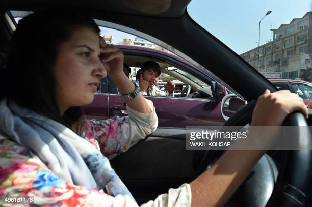 To go with story 'Afghanistanculturesocialwomendriving FEATURE' by Usman Sharifi In this photograph taken on September 4 Afghan woman Rokhsar Azamee...