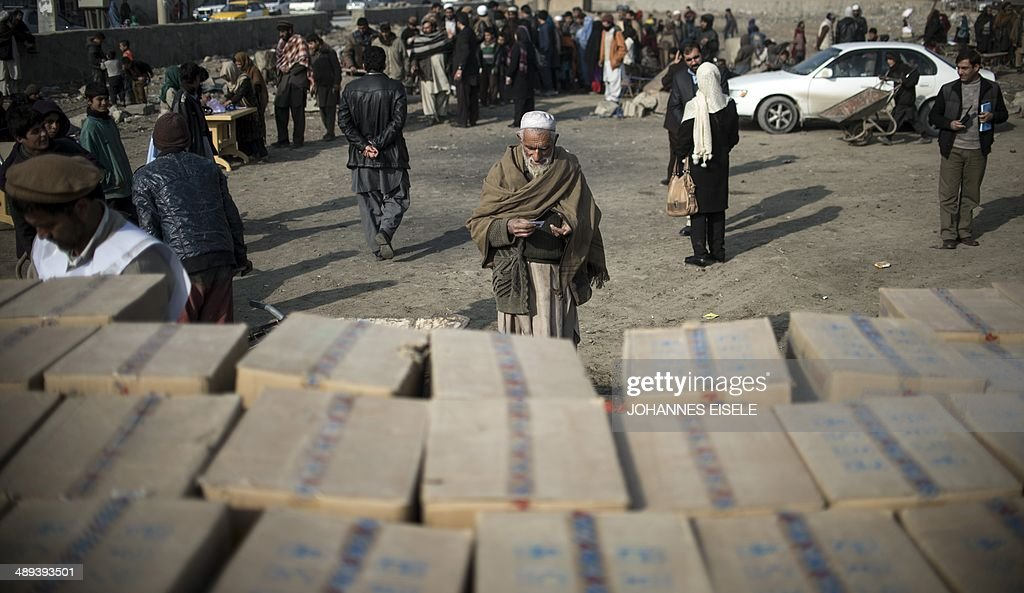 To go with story 'Afghanistanfightingdisplacedaid' by Edouard GUIHAIRE In this photograph taken on January 26 elderly Afghan man Gul Agha from Surobi...