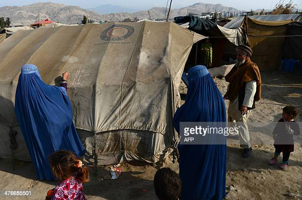To go with story 'AfghanistanhealthunrestPakistanFEATURE' by Ben Sheppard In this photograph taken on February 24 2014 Afghan burqaclad woman health...